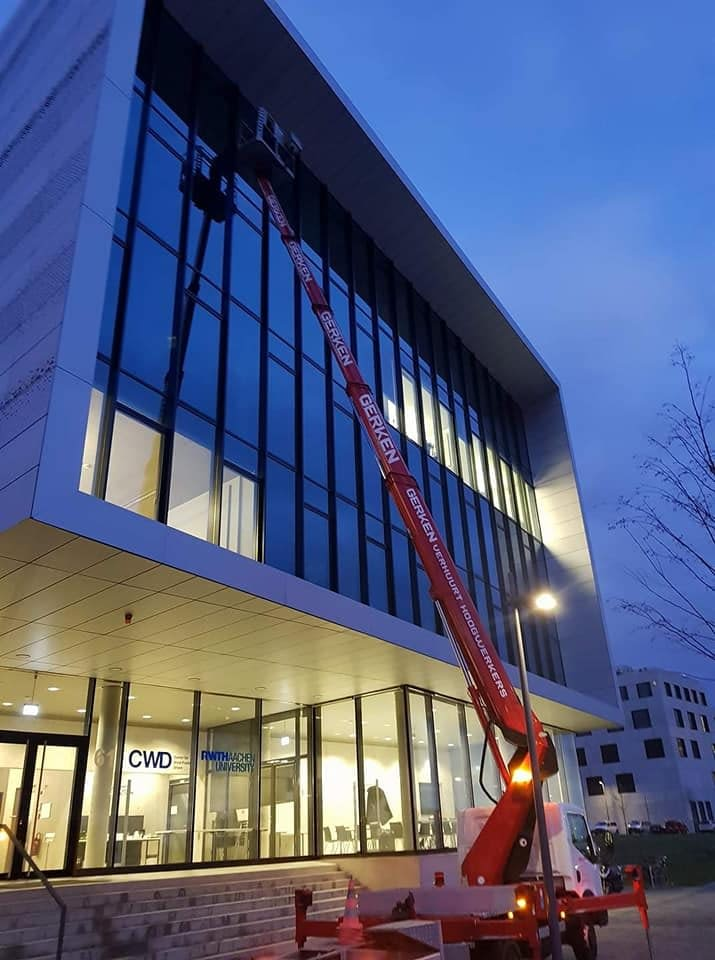 Truck Mounted Boom Lift for Cleaning Windows - Downtown Denver CO